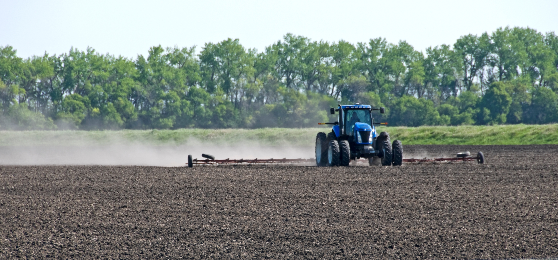 Blue-Tractor-Dragging-Field6